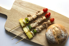 Barbecue pork stick and bread on wooden. top view Royalty Free Stock Images