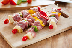 Barbecue with pork,vegetable before grill on wooden board Royalty Free Stock Photography