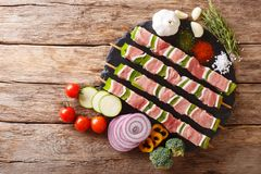 For barbecue raw shish kebab with pepper and lard on skewers close-up and ingredients, vegetables, spices, herbs. Horizontal top. For barbecue raw shish kebab stock image