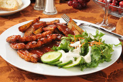Barbecue ribs with potato wedges Royalty Free Stock Photos