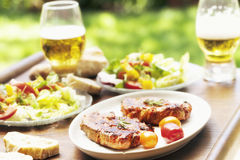 Barbecue with roasted pork  salad and beer Stock Photo