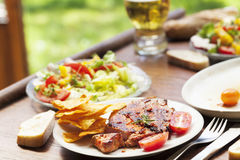 Barbecue with roasted pork  salad and beer Stock Photos