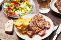 Barbecue with roasted pork  salad and beer Royalty Free Stock Photo