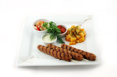 Barbecue with salad on a square plate Royalty Free Stock Image