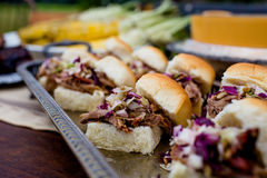 Barbecue Sandwiches at a Fall Outdoor Dinner Party. BBQ pork sandwiches served at a fall outdoor dinner party Royalty Free Stock Images