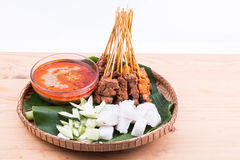 Barbecue satay served on traditional rattan plate with banana le Royalty Free Stock Image