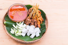 Barbecue satay served on traditional rattan plate with banana le Stock Photo