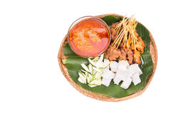Barbecue satay served on traditional rattan plate with banana le Royalty Free Stock Photography