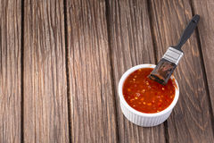 Barbecue sauce with basting brush Royalty Free Stock Image