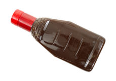 Barbecue sauce with red cap Stock Images