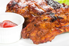 Barbecue with sauce and vegetables royalty free stock image