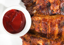 Barbecue with sauce and vegetables stock photos