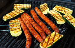 Barbecue with sausage and grilled zucchini Stock Photo