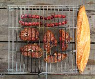 Barbecue sausages lamb meat grill bread Royalty Free Stock Images