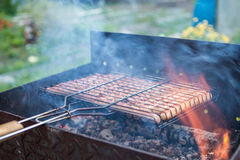 Barbecue sausages prepared on grill Royalty Free Stock Photo