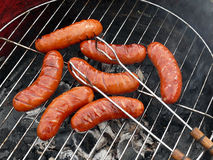 Barbecue, sausages & tongs royalty free stock photography
