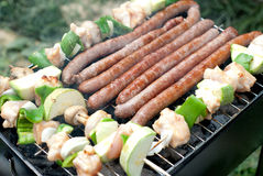 Barbecue with sausages and vegetables Royalty Free Stock Images