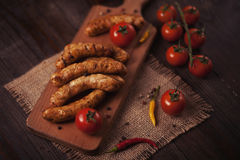 Barbecue sausages on the wooden table Stock Photos