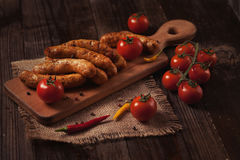 Barbecue sausages on the wooden table Royalty Free Stock Image
