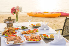 Barbecue seafood for dinner by the sea Royalty Free Stock Images