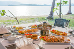 Barbecue seafood for dinner by the sea. Sunset stock photography