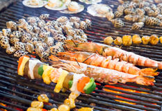 Barbecue seafood on the flaming grill. Stock Photos