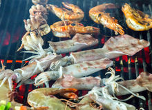 Barbecue seafood on the flaming grill. Stock Photography
