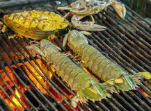 Barbecue seafood on the flaming grill. Royalty Free Stock Photography