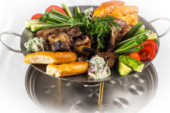 Barbecue set with vegetables, greens and bread. Barbecue with vegetables and greens Royalty Free Stock Photography