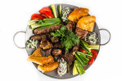 Barbecue set with vegetables. Greens and bread Stock Images