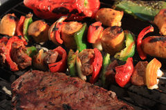 Barbecue shish kabob and steak Royalty Free Stock Photography