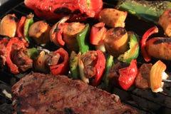Barbecue shish kabob and steak royalty free stock photography