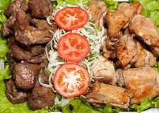 Barbecue, shish kebab from chiken and pork Royalty Free Stock Photography