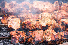 Barbecue a shish kebab pork on skewers over charcoal Royalty Free Stock Images
