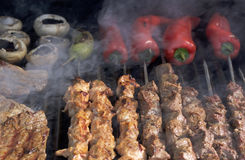 Barbecue. Shish kebab, steak, with grilled peppers and mushroom Royalty Free Stock Images