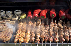 Barbecue. Shish kebab, steak, with grilled peppers and mushroom Royalty Free Stock Photos