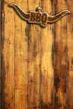 Barbecue sign on wooden wall Stock Image