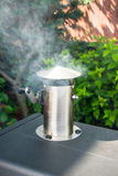 Barbecue smoker. Slowly cooking meat on the grill stock photo