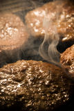 Barbecue smoking meatballs Royalty Free Stock Photo