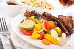Barbecue spare ribs on a plate Royalty Free Stock Images