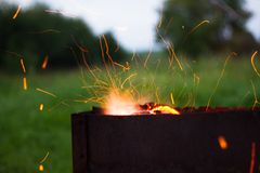 Barbecue sparks fly from evening dinner Royalty Free Stock Photos