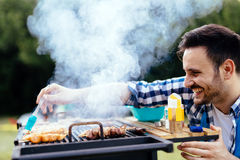Barbecue spices being added to meat. Barbecue spices and seasonings being added to meat stock image