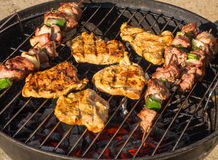 Barbecue with steak and shish kebab Stock Photography