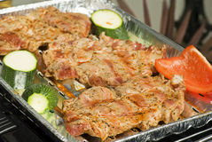 Barbecue Steaks. Half row barbecue steaks on a aluminium cup on the grill Royalty Free Stock Images