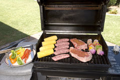 Barbecue with steaks, brats chicken and corn Royalty Free Stock Image