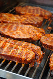 Barbecue Steaks on Grill Stock Images