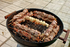 Barbecue sticks on mangal. Outdoor Stock Images