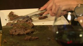 Barbecue on the stone. The girl in the restaurant prepares meat on a hot stone stock video