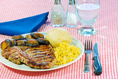 Barbecue T Bone steak dinner. With a napkin and cutlery Stock Photos