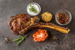 Barbecue Tomahawk Steak on grill roast with herb prepared for grill